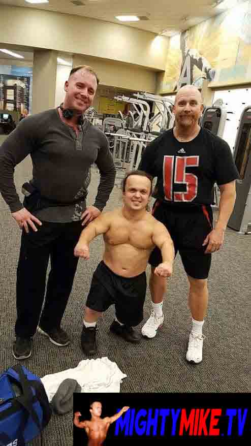 Dwarf talent Mighty Mike, Muscle little person training lifting weights working out in LA fitness gym. Dwarf Acts Mighty Mike performs, fire breathing Midget, juggling Dwarf hire: call: 1-714-514-5514 or mightymikemurga@me.com